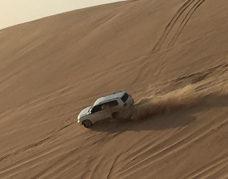 Land Cruiser dune bashing at desert